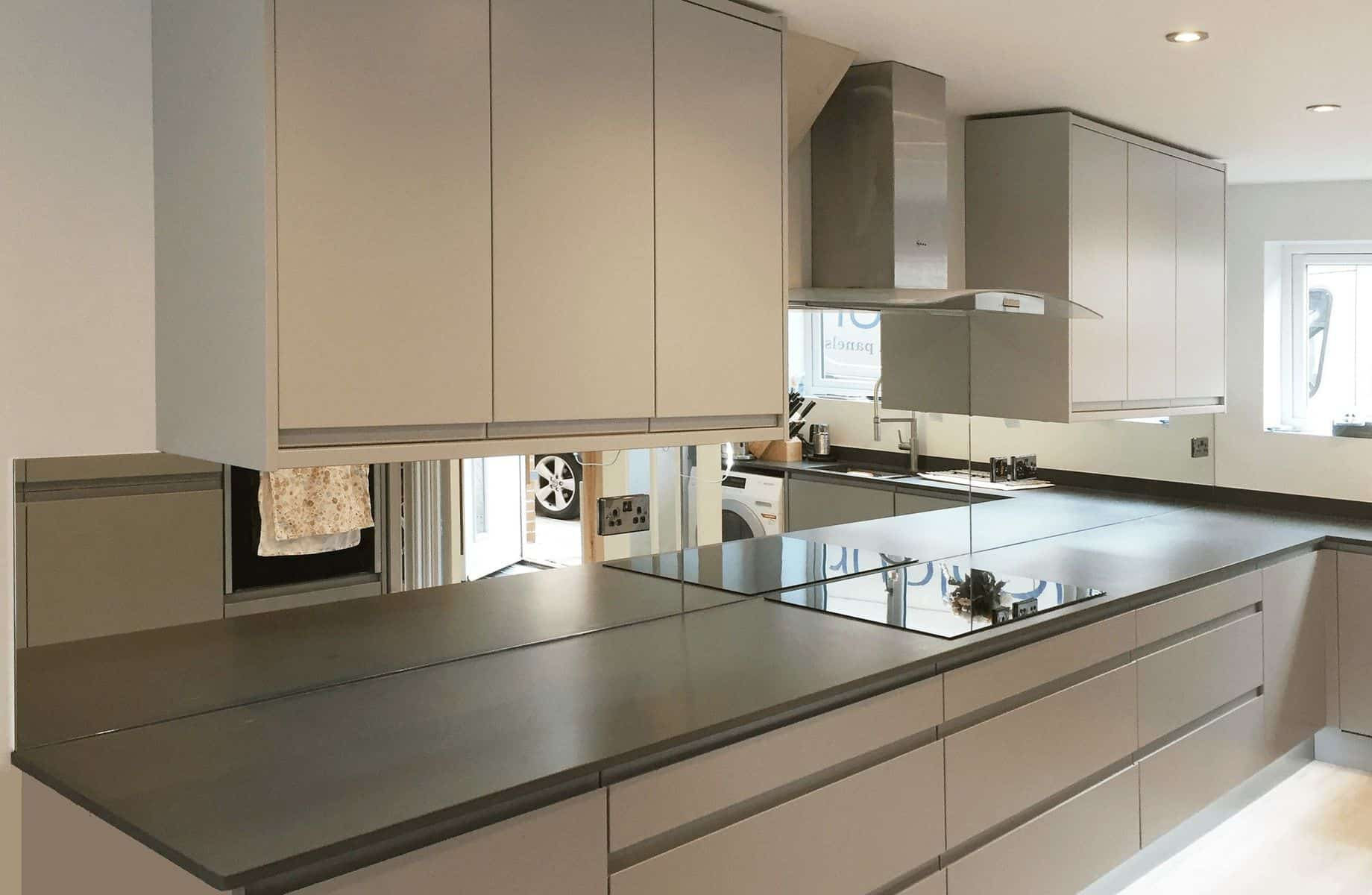 Mirror glass splashbacks in Silver Mirror produced for Nailsea Electrical